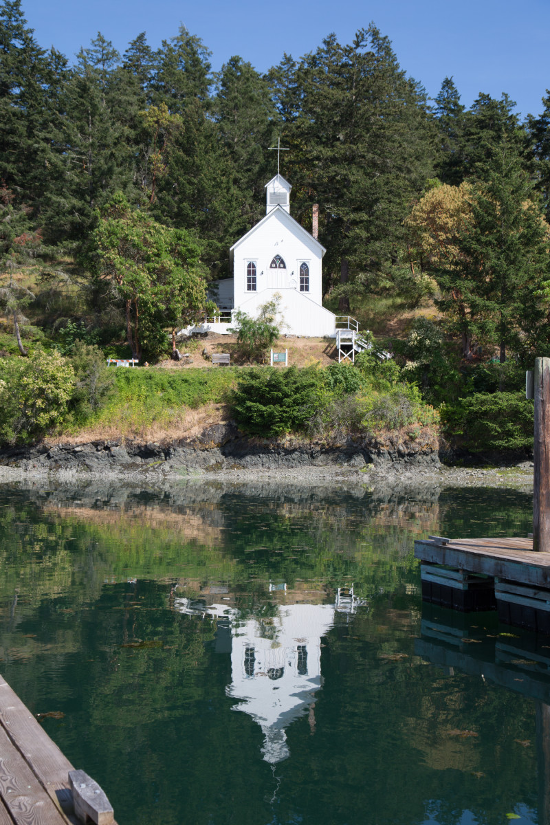 The historic Our Lady of Good Voyage Chapel overlooks Roche Harbor Marina, San Juan Island.