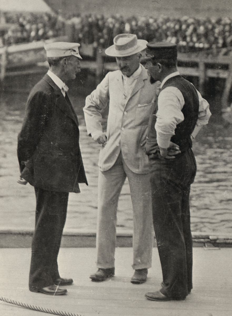 Lord Dunraven; Valkyrie III's designer, G.L. Watson; and the yacht's skipper, Edward Sycamore discuss matters before before a Cup match in 1895.