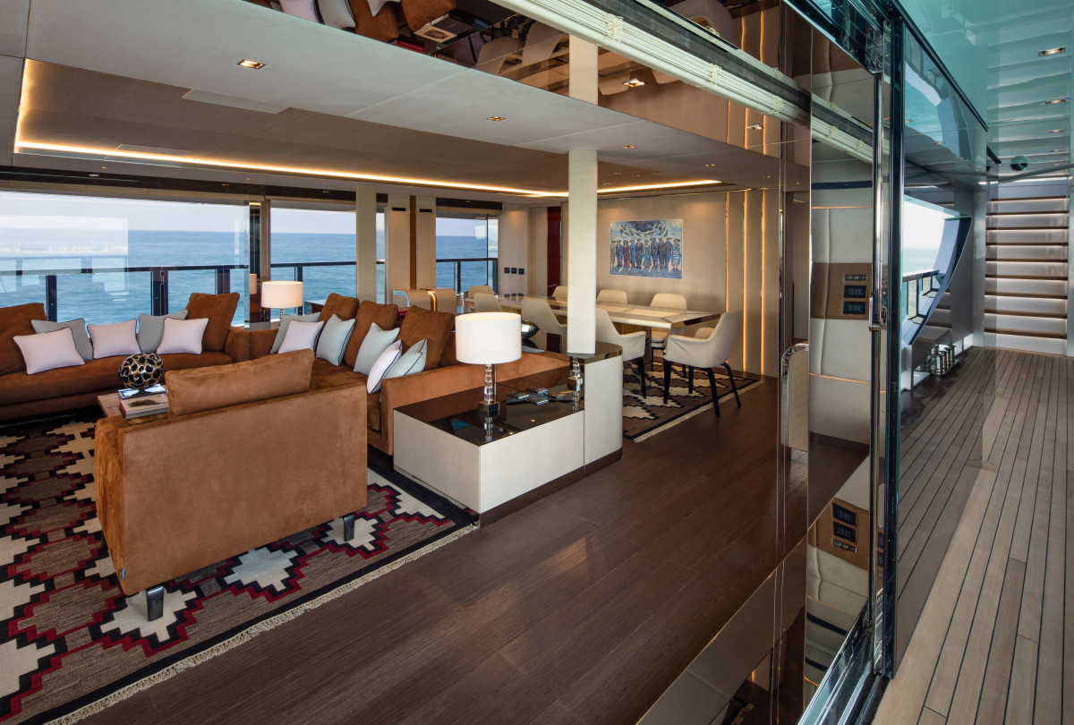 Sliding glass doors open the main salon to the side decks.
