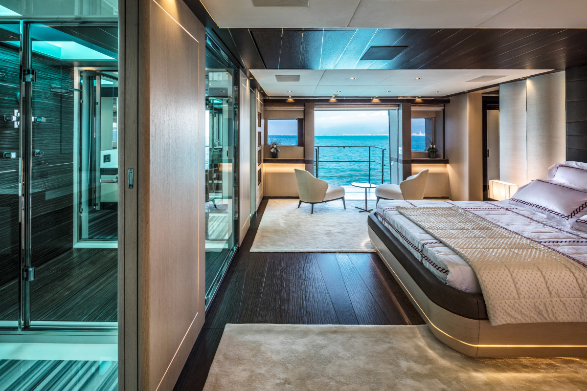 The plentiful use of glass and mirrors bounce light around the owner's stateroom.