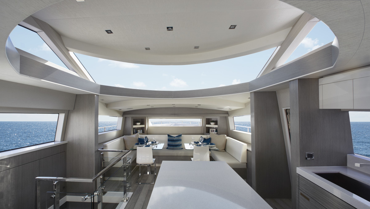 A wraparound windshield acts as a skylight that floods the country kitchen-style galley and dining area with natural light.