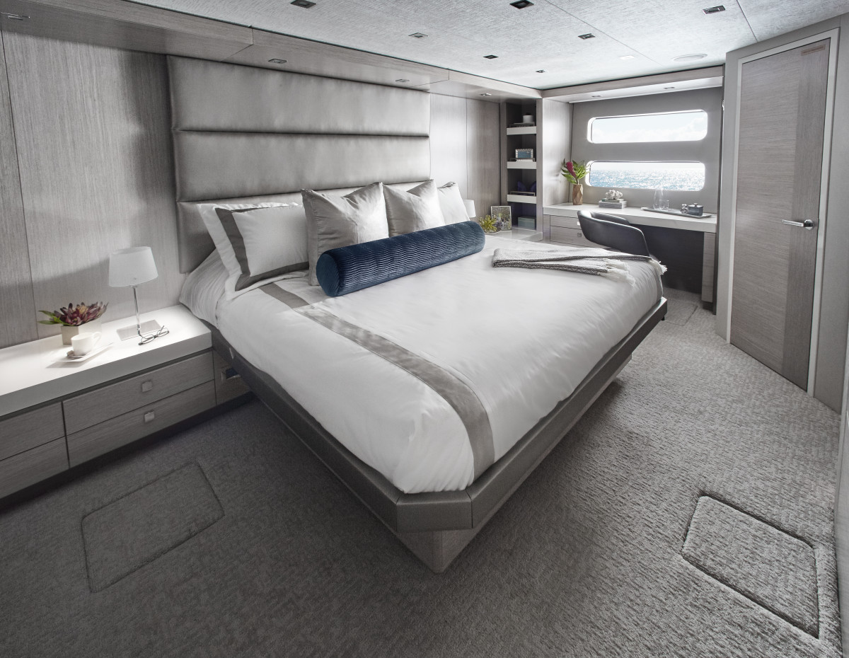 Belowdecks, the full-beam master suite includes a walk-in closet, a twin vanity, bureaus and a head with shower.