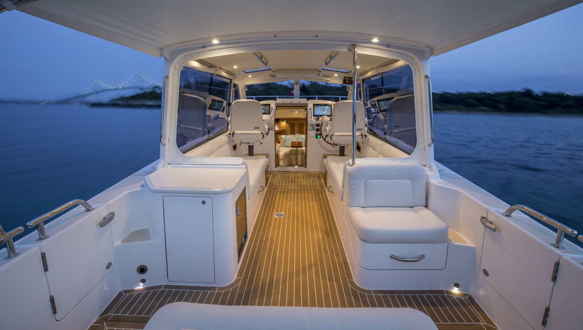 The 35z's cockpit is the social center of the boat. Its windscreens open, and the sides can be equipped with sliding windows or Strataglass. An optional Bimini can cover the aft section for protection from weather.