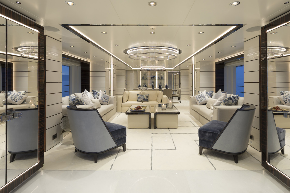 The elegant main deck salon and dining area have generous  headroom with strip lighting in the recesses. (Photo by Guillaume Plisson)