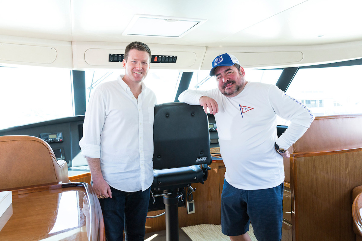 Lagasse and the writer chat in the enclosed flybridge on his 70-foot Viking, Aldente.