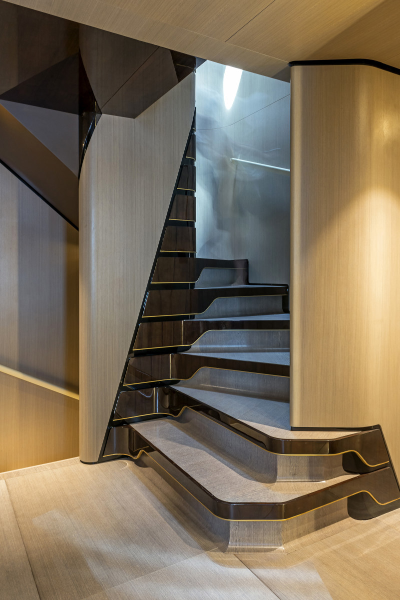 The main staircase comprises all three wood varieties on board: brushed teak, limed sycamore and glossy tineo.