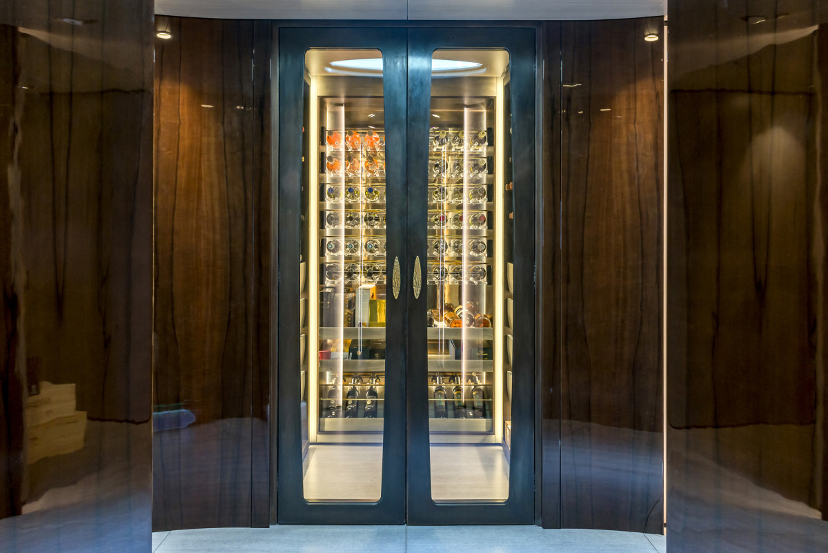 A computer-controlled, 500-bottle wine store is the centerpiece in the main deck foyer.