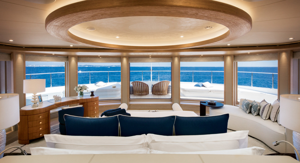 The master suite has a panoramic view and doors to port and starboard.