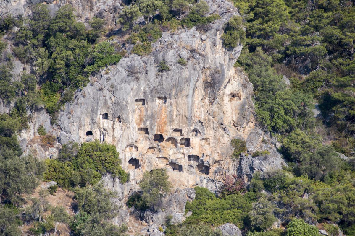 Carian and Lycian rock tombs tower above the scenic and aptly named Tomb Bay. The ancient city of Crya can still be picked out amid the olive and oleander trees.