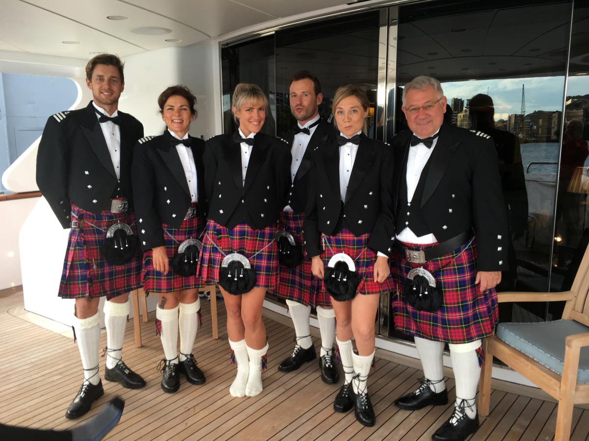 The crew dressed in McPherson tartan.