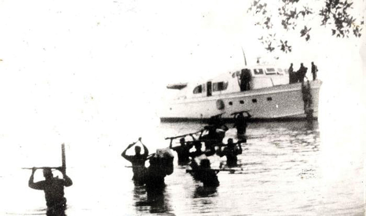 This vintage 1956 picture shows fighters disembarking from Granma after she was intentionally run aground in eastern Cuba.