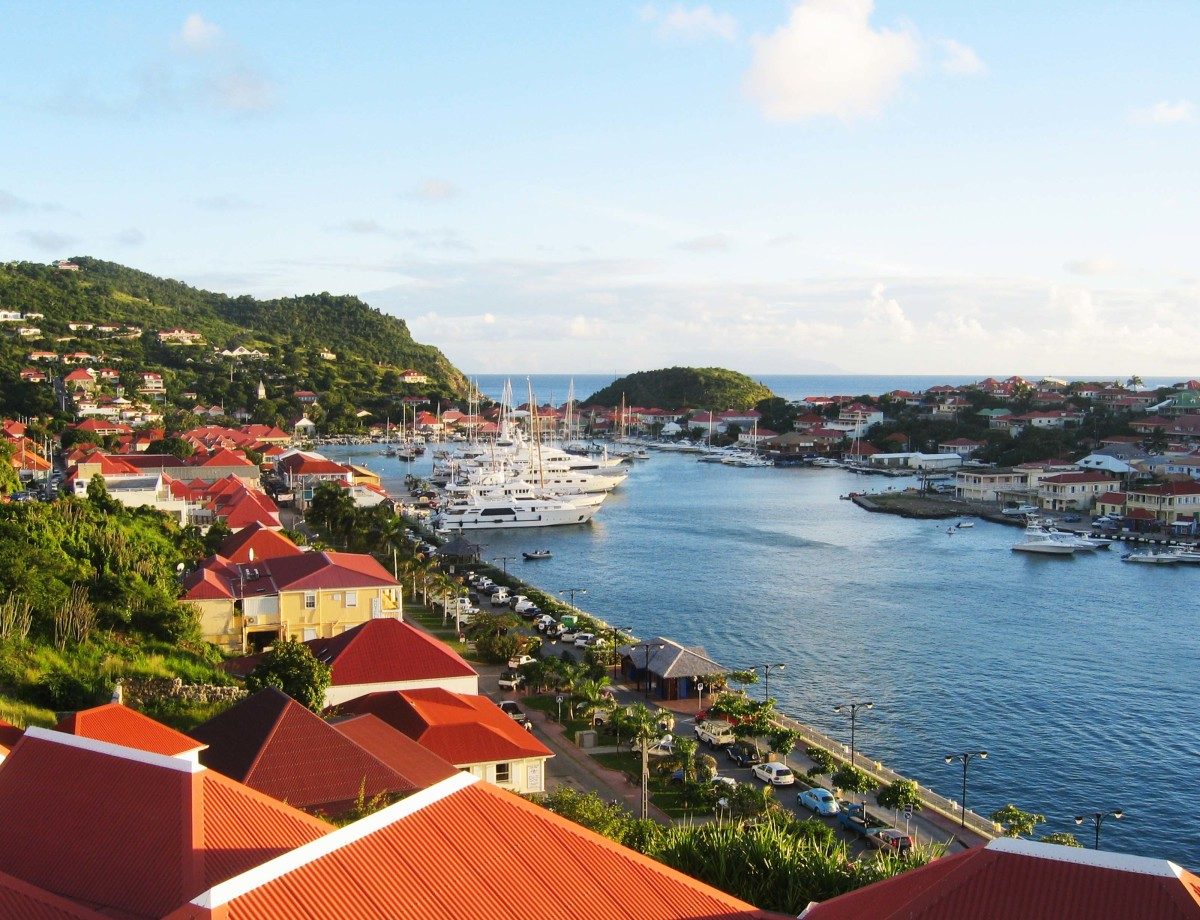 The horseshoe-shaped harbor of Gustavia in St. Barths, rimmed with boutiques and cafés, can accommodate a handful of superyachts at the quay. (Shutterstock photo, courtesy of Edmiston)