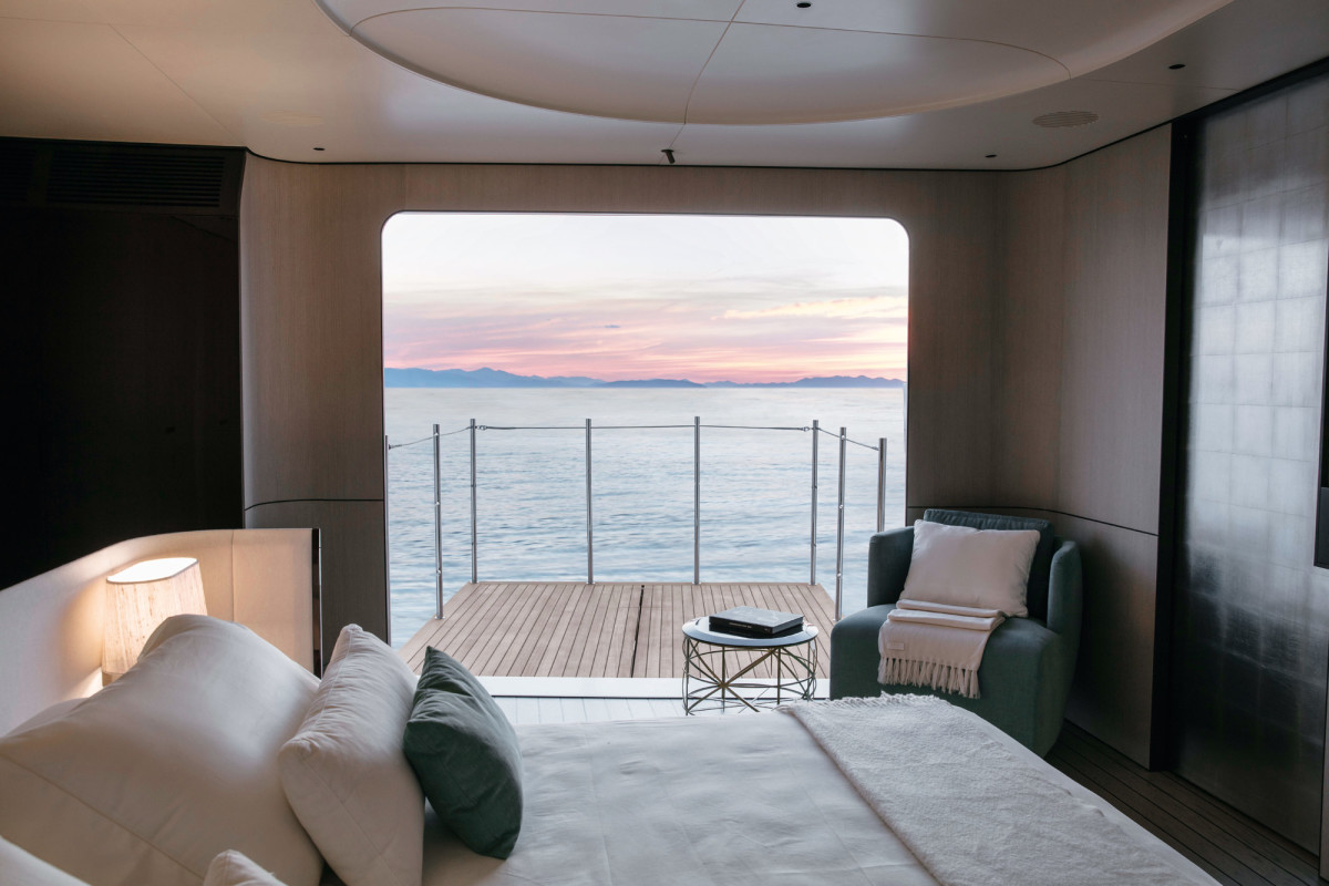 The window in the 35 Metri's master stateroom balcony folds down, the deck slides out and the rails deploy themselves. All you do is watch.
