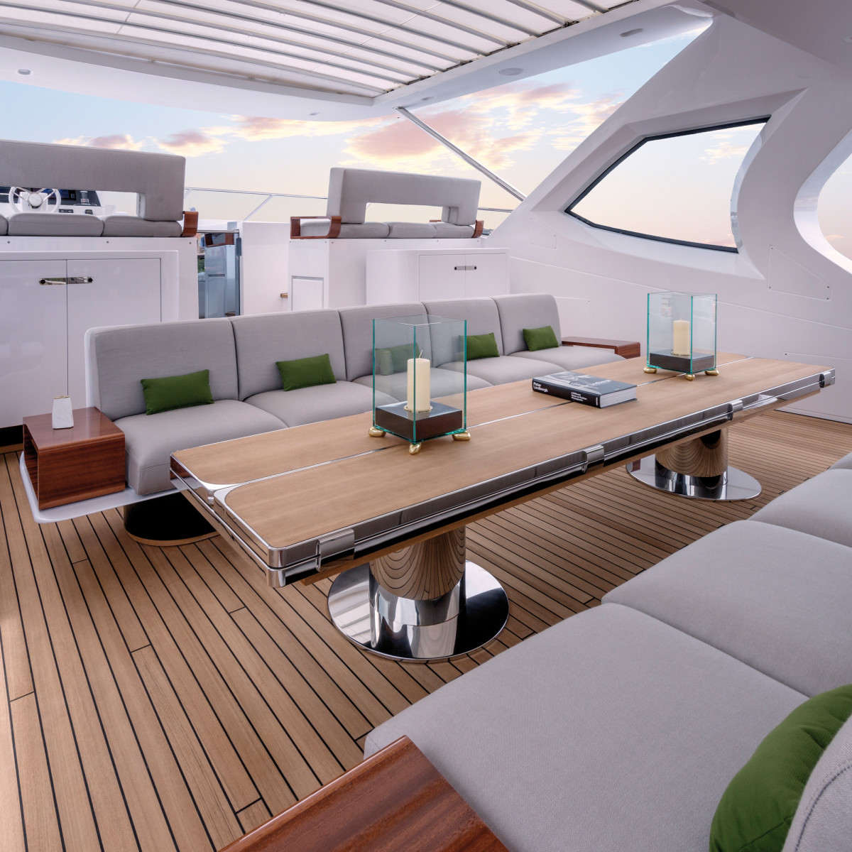The flybridge seating exhibits integrated, wood end tables.