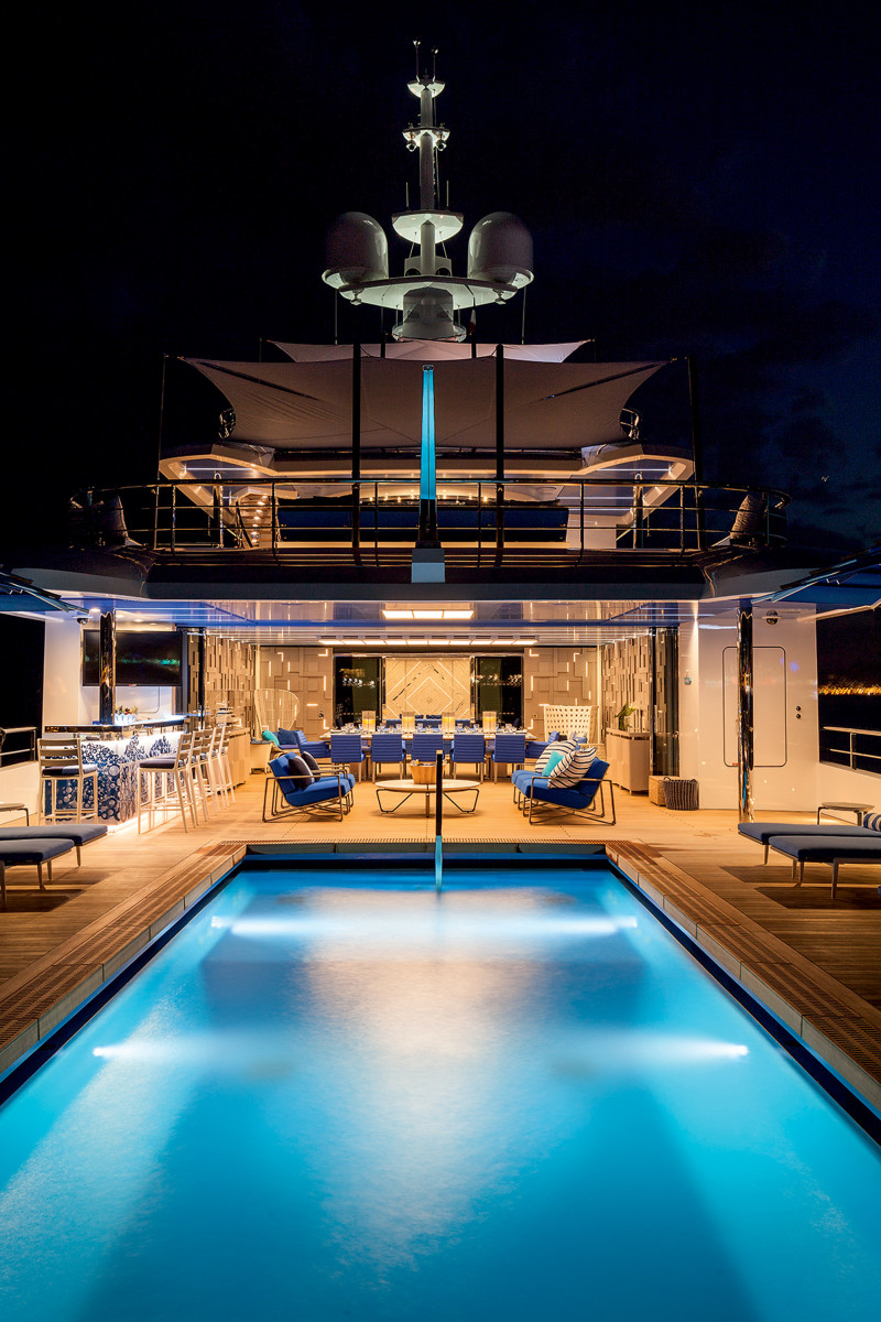 The yacht's blue swimming pool is singularly striking. It is among the largest pools ever built on any yacht, measuring nearly 33 feet by 13 feet (10 meters by 4 meters), and is designed to be a family focal point.