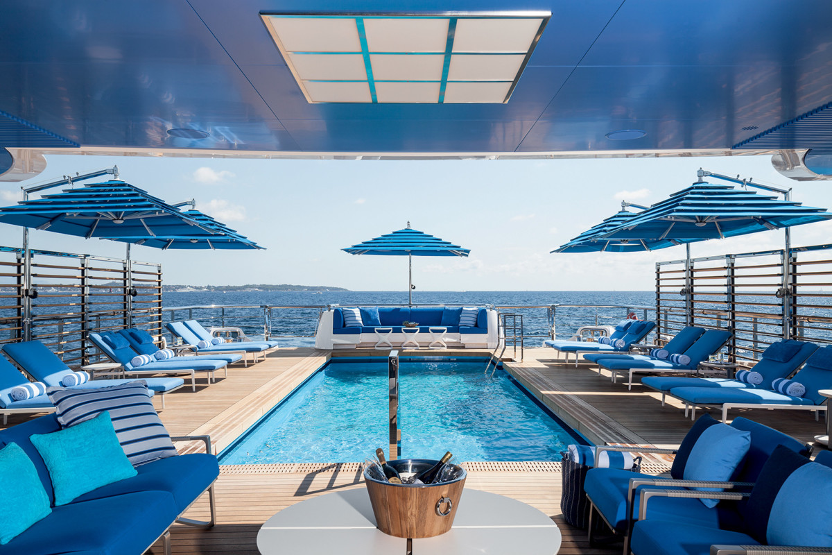 The aft deck swimming pool is one of the largest ever built on a yacht of any size.