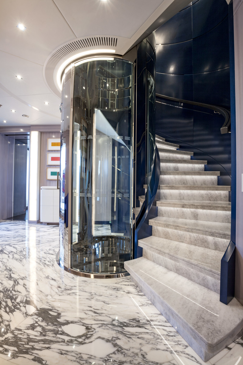 The central lobby has an elevator that services four decks, and a marble staircase with leather and stainless steel accents.