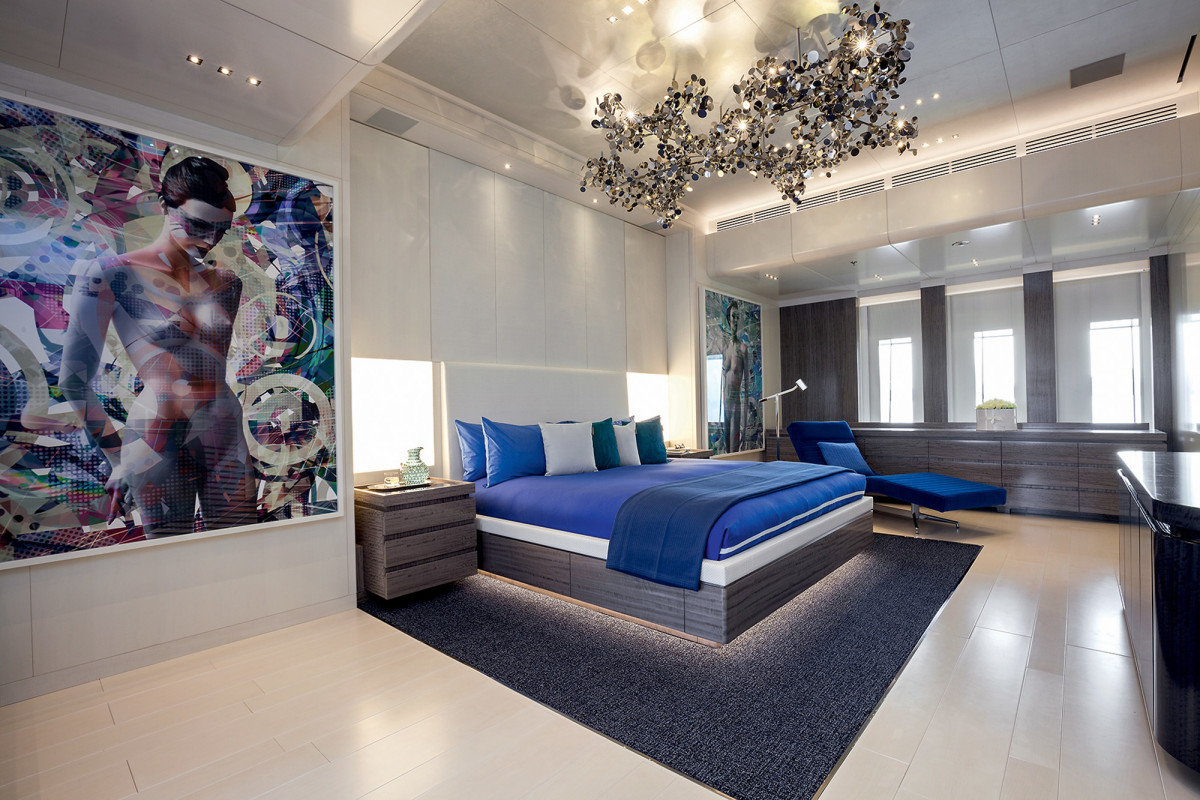The 10-foot ceilings in the master suite accommodate the chandelier. Seasense has a magnificent art collection including three pieces by French artist Valérie Belin.
