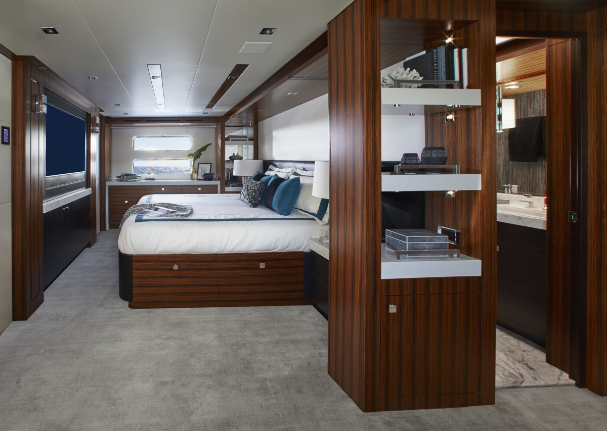 The full-beam master stateroom is belowdecks with large hullside windows.