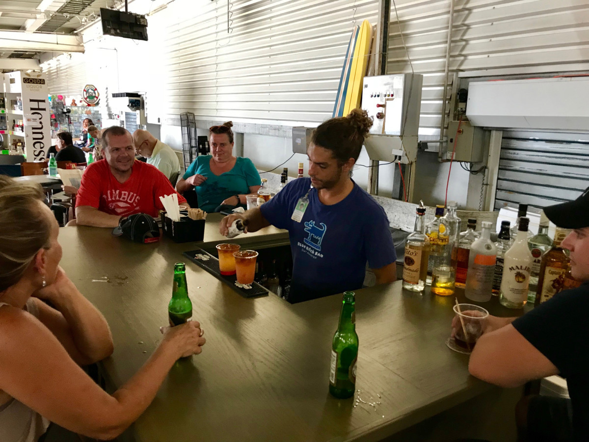 The most popular man at St. Martin's Princess Juliana International Airport is the bartender slinging rum punch at the terminal's makeshift bar.