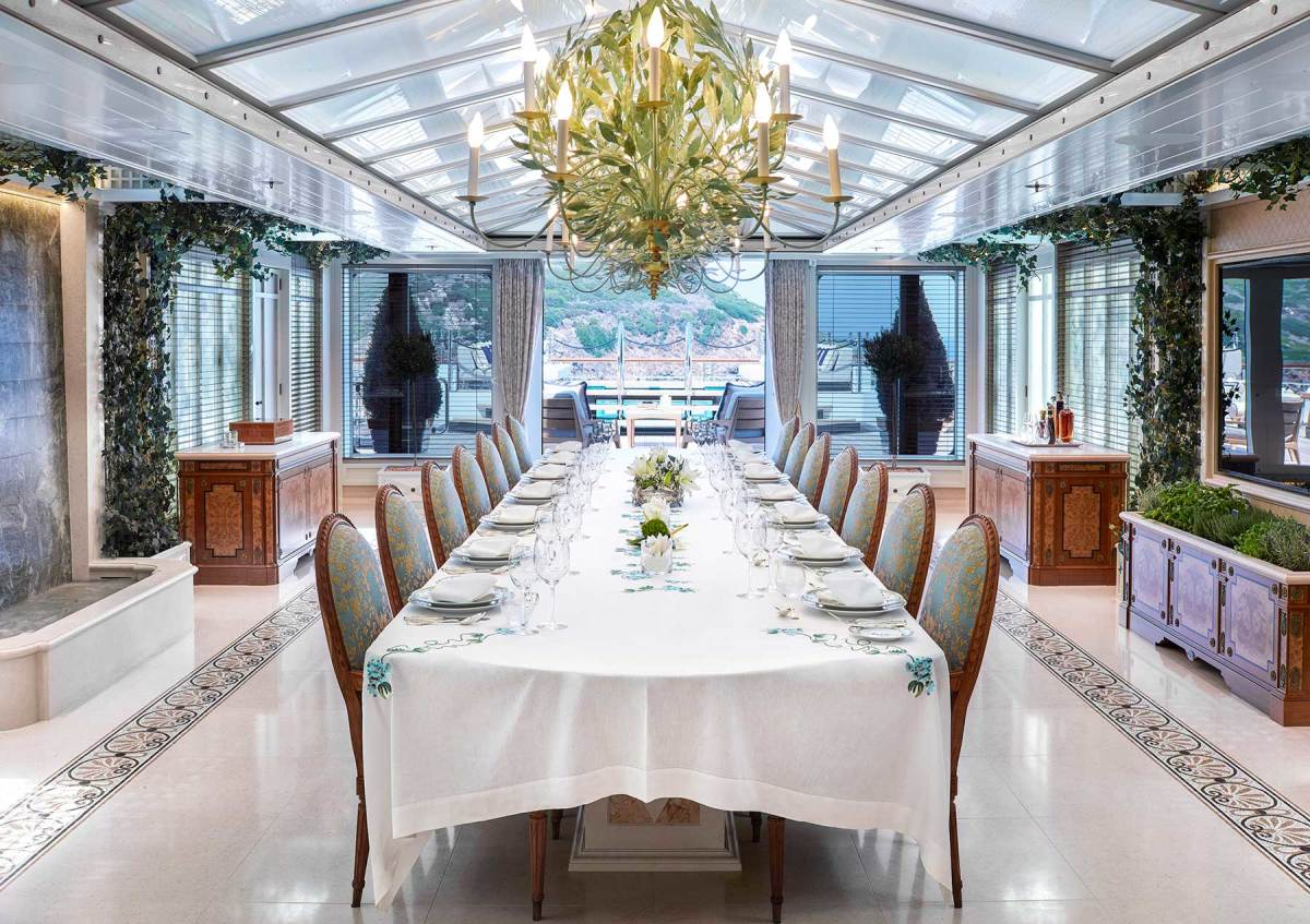 The winter garden, located on the sundeck, has a large formal dining table serviced by a second galley.