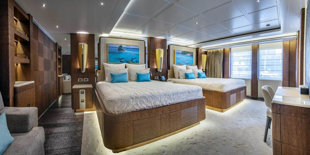 The stateroom layout is unusual in that there are three VIPs on the upper deck, separate masters on the main and lower decks, and another six guest staterooms on the upper and lower decks, all of which are connected by stairs and a central elevator.