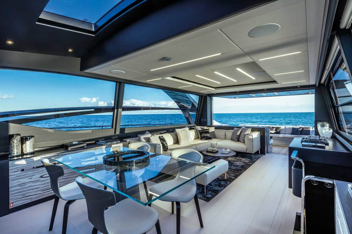 Freestanding furniture, huge windows, generous headroom and an abundance of space in the Pershing 8X's deck salon do not seem  to quite belong to a 48-knot performance yacht.