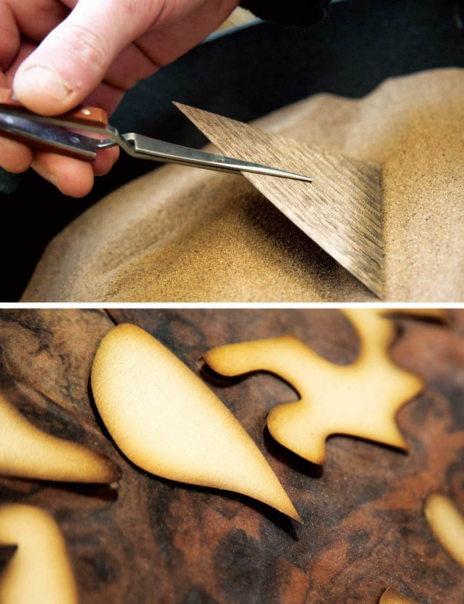 Thin veneers carefully burned in hot sand provide a subtle 3-D effect when they are then inlaid into a wood surface.
