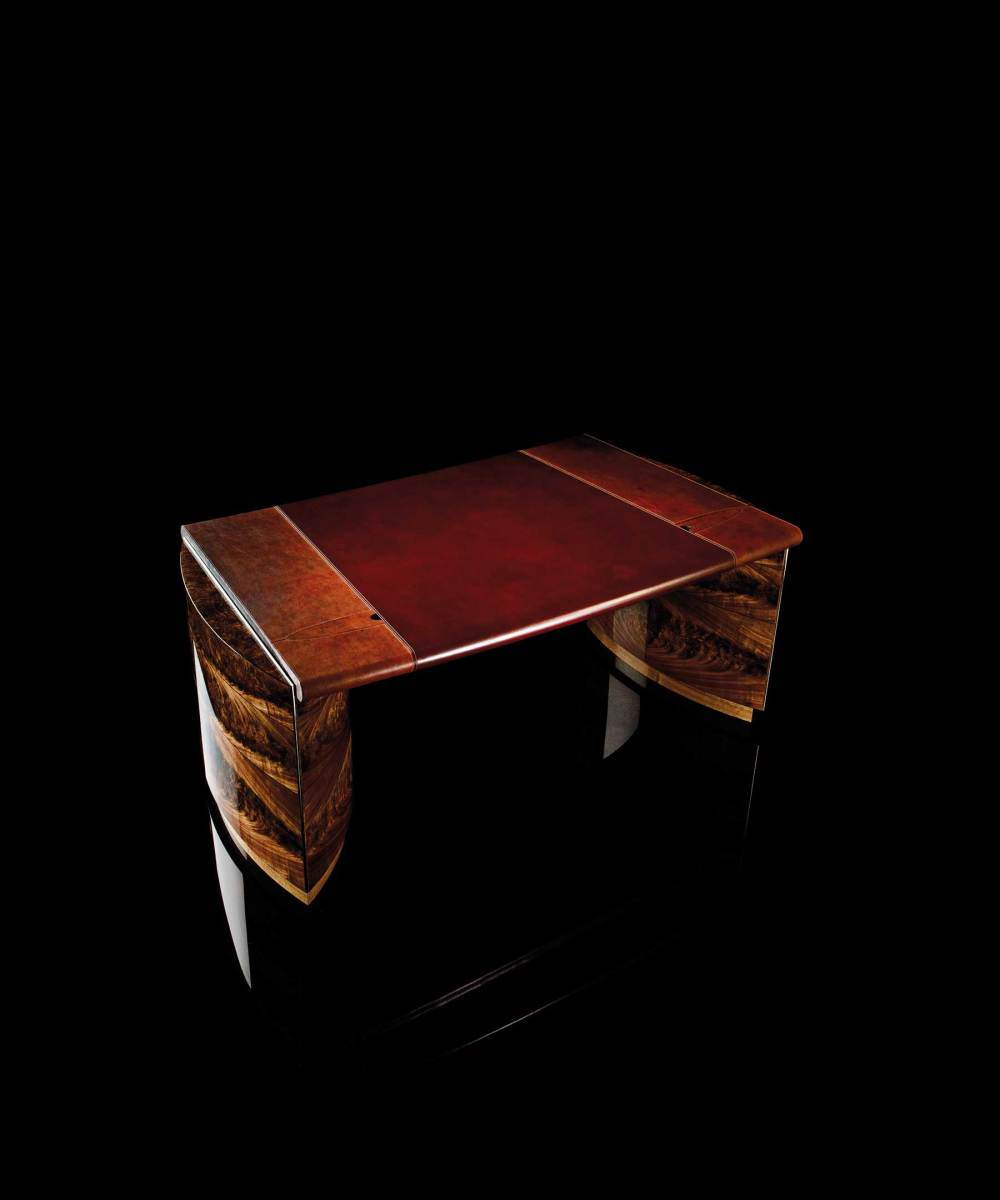 This gentleman's desk is made from American black curl walnut with a top surface of reindeer leather salvaged from a Russian ship that sank in 1786.