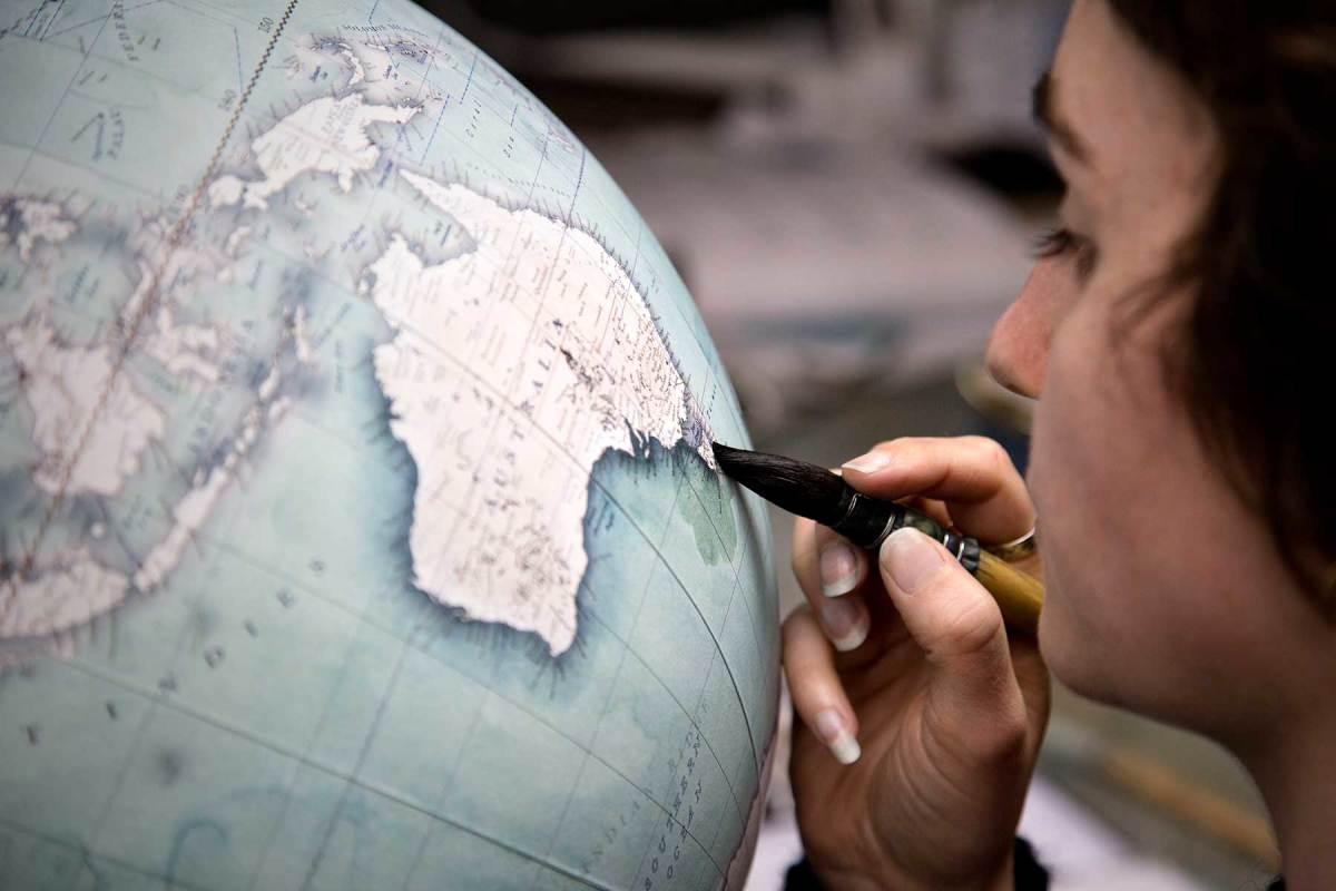 A watercolorist creates the darker 'wash' around the coastline of Australia and Tasmania.