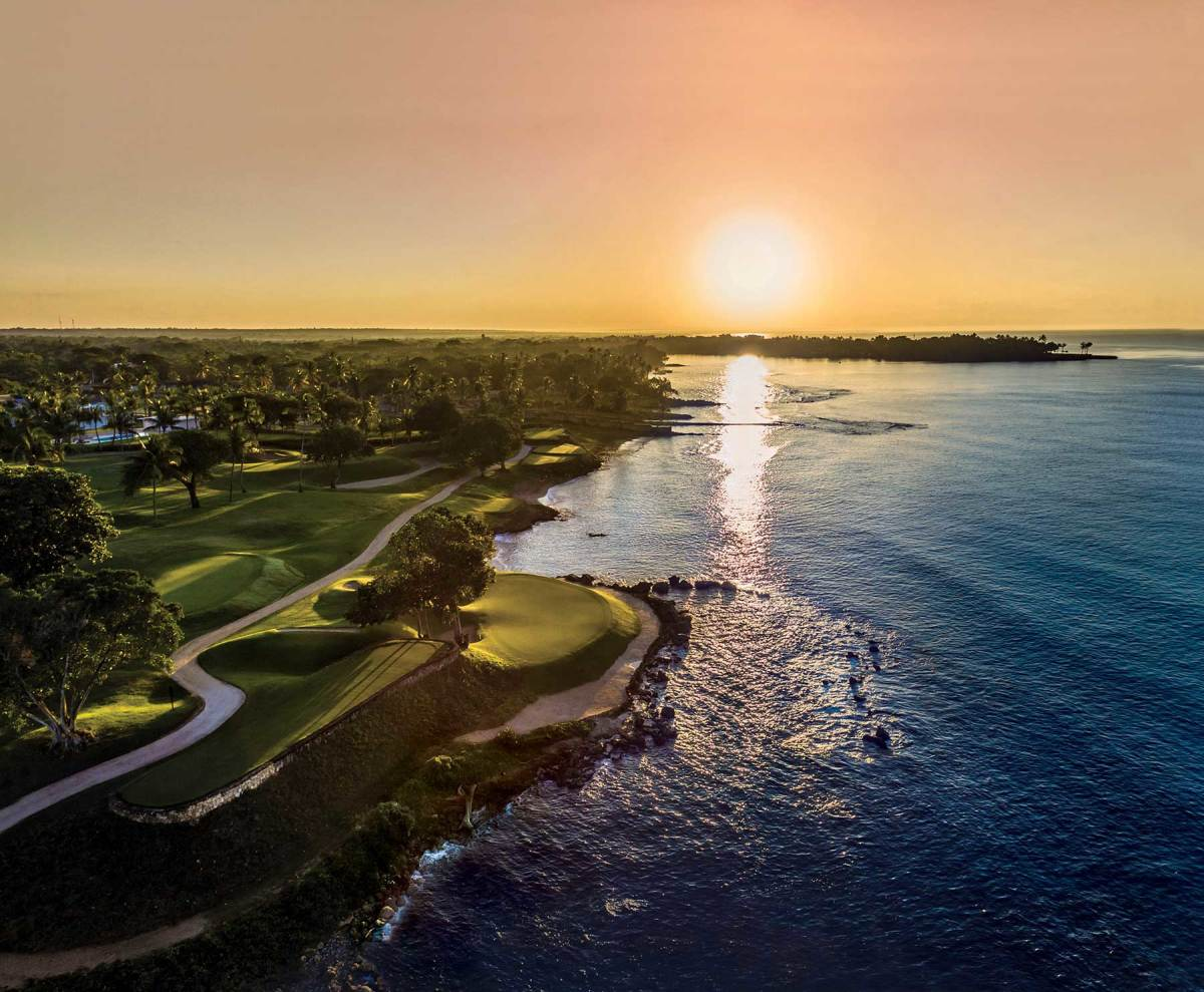 Called 'diabolical,' the fifth hole on Pete Dye's Teeth of the Dog course is dotted with trees, slopes away from the green, and has steep runoffs into a trap and the sea.
