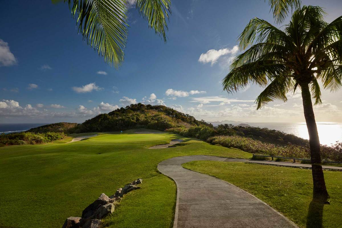 Reaching the green on several holes on the Canouan course requires a fine eye (and feel) for the breezes coming over the ridges.