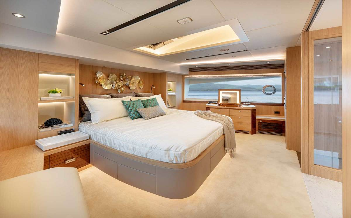 The main deck master stateroom takes advantage of the full beam with oversized windows and no side decks to intrude on privacy.