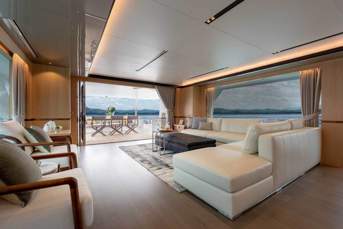 The salon doors fold completely out of sight for a seamless transition to the alfresco dining on the aft deck.
