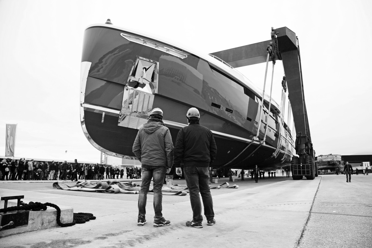 Workers look on as Utopia IV prepares for her launch last March. (Photo by Justin Ratcliffe)