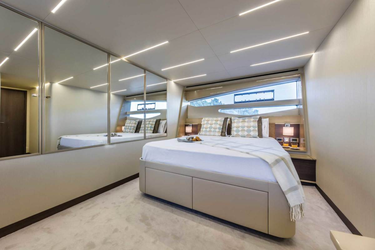 Serene and bright full-beam master stateroom with mirror-fronted hanging lockers.