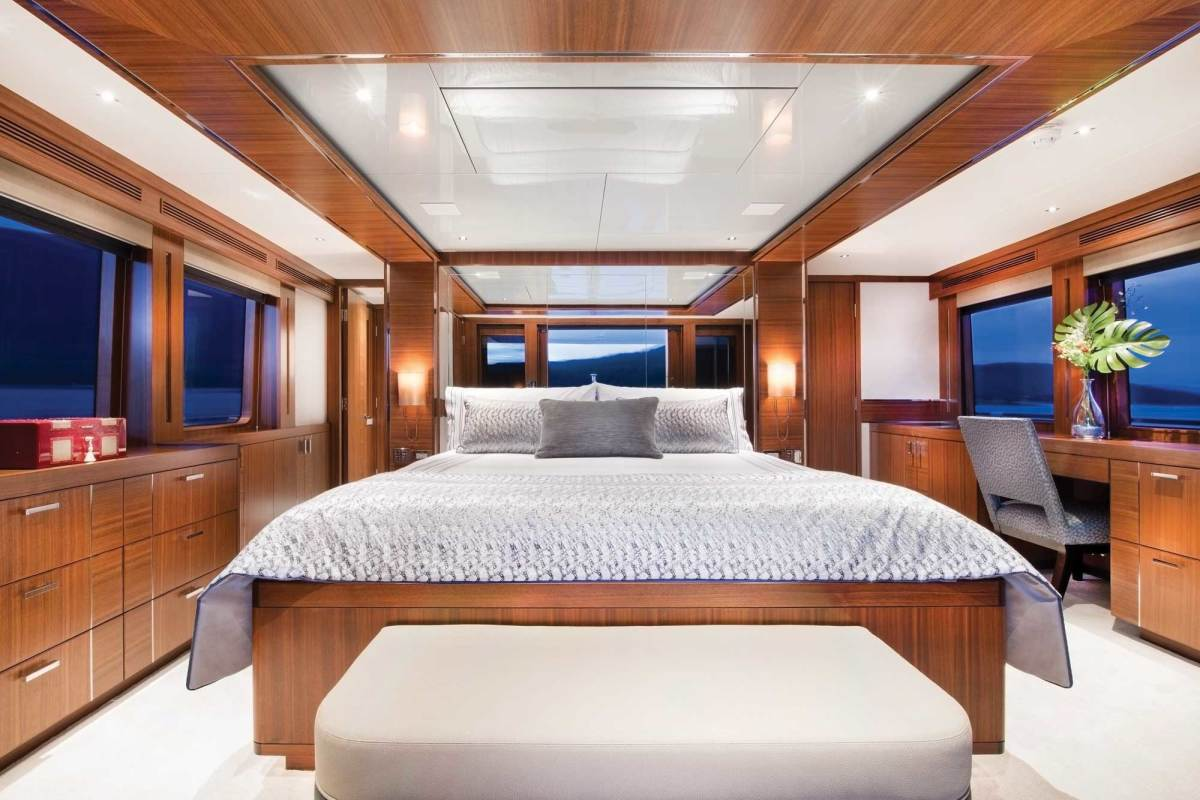 As the master stateroom illustrates, detailing throughout the boat is clean and beautifully executed. Stainless steel inlays in the wood overhead panels and varied veneer arrangement in cabinet faces heighten interest and provide relief.