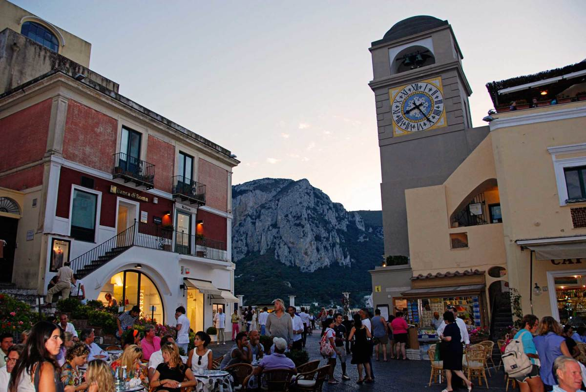 Piazza Umberto I is the main square in the historic center of the island of Capri. Replete with bars, cafés and shops, the square is a popular meeting place for tourists and locals alike—with the clock tower serving as a landmark.