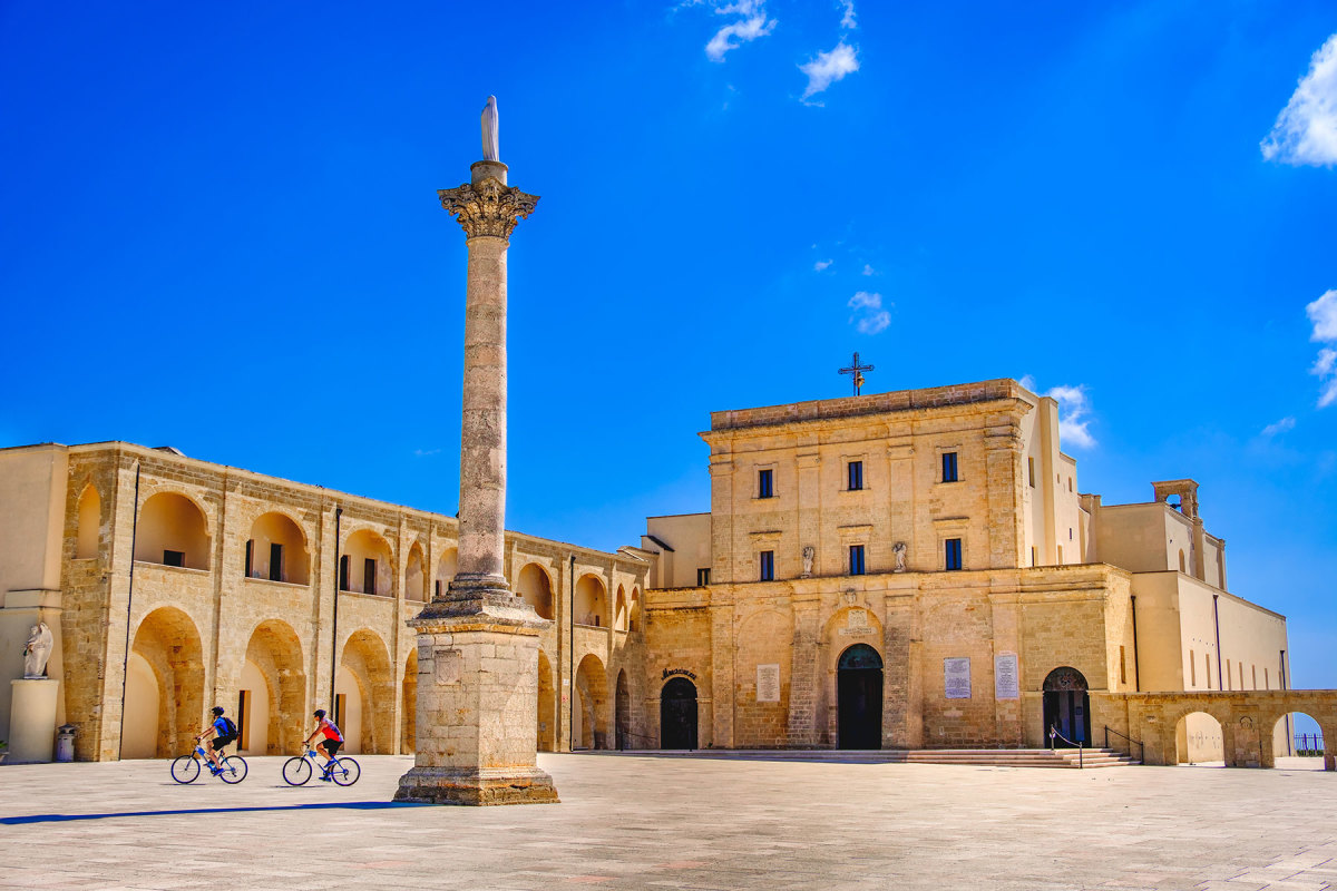 Cyling by Basilica Sanctuary of Santa Maria de Finibus Terrae in Lecce.