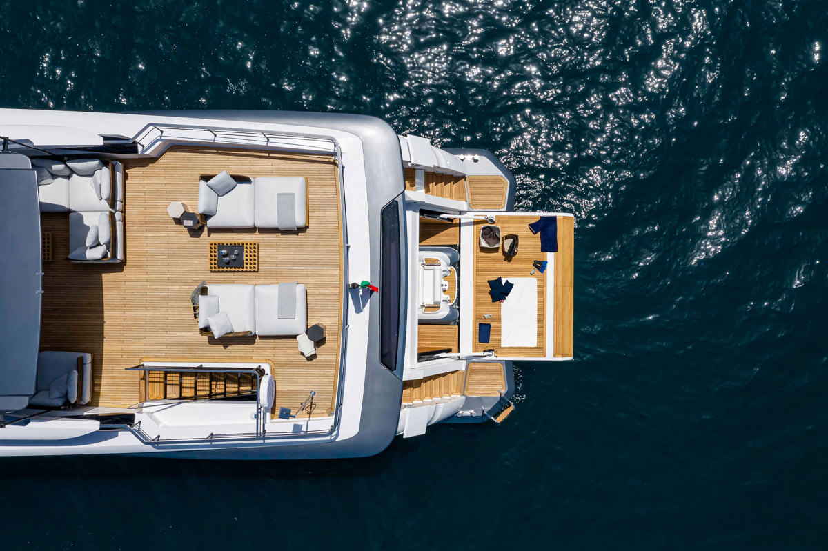 Ferretti's Dual Mode Transom system consists of two hatches that cleanly cover the stern staircases when underway, and expose them when at anchor. Previous spread: Based on flamed and sandblasted oak, the interior design by Francesco Paszkowski and Margherita Casprini has an elegant, home-away-from-home feeling.