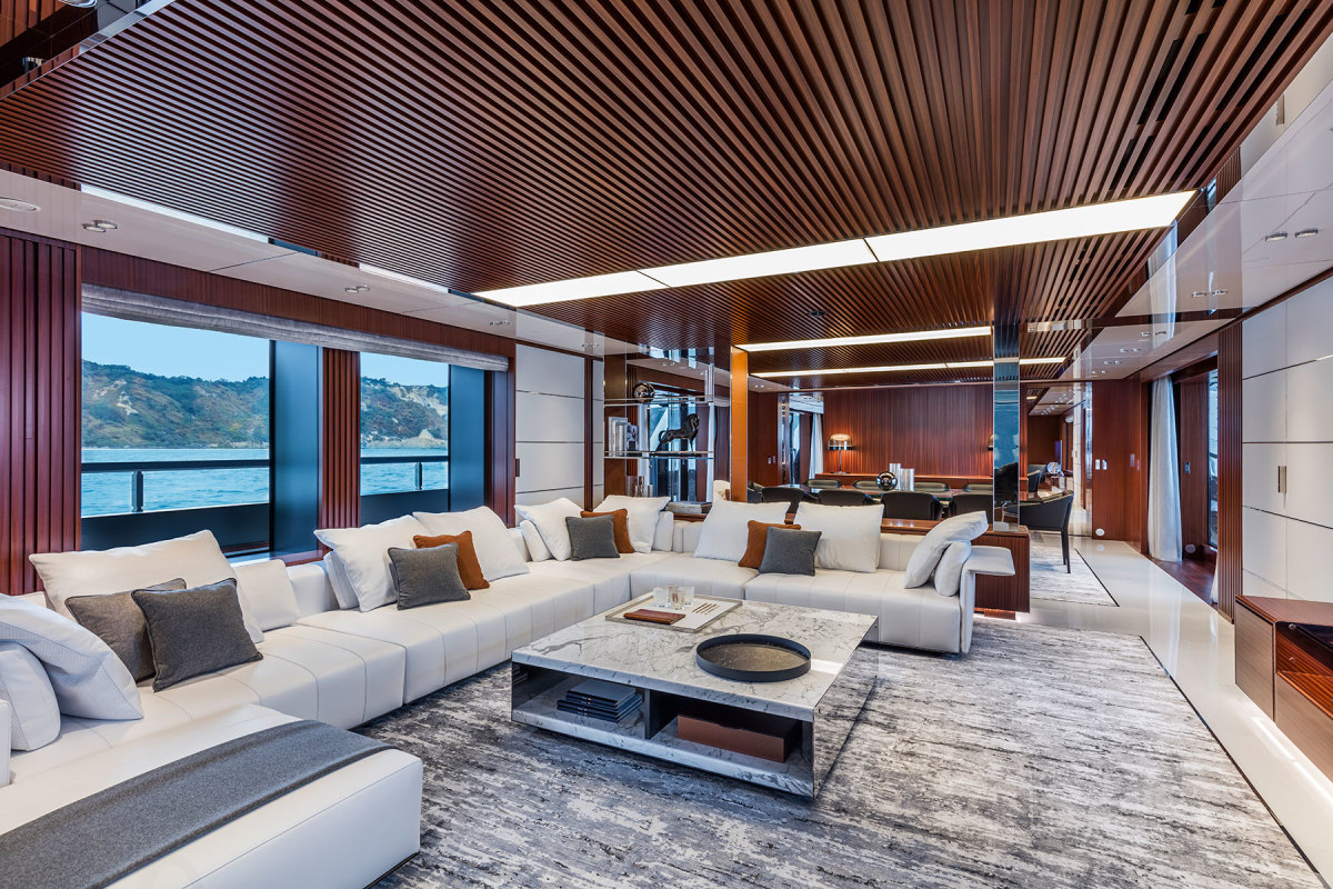 Warm mahogany, statuario marble, light gray leather and polished accents are the cornerstone of the interior styling by Officina Italiana Design. Previous spread: Race shows off her gracefully self-assured profile.