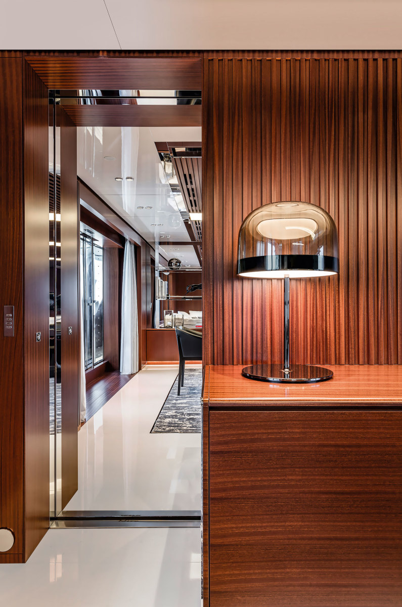 Slatted mahogany and stainless steel accents help define the contemporary interiors.