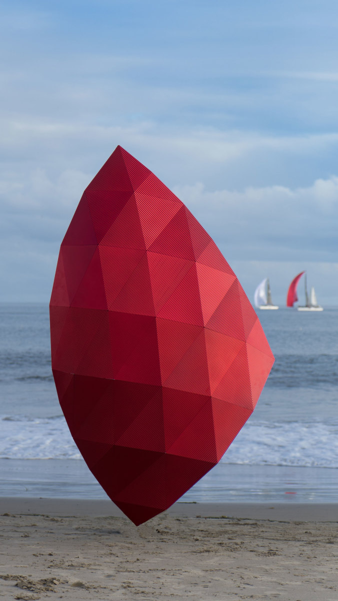 Alex Rasmussen had the idea to create this red kite as an objet d'art and at the same time show the flexibility of aluminum—how it is not only colorful, but also versatile. This large piece is modular, making it easy to be broken down so that it is convenient to store and to ship.