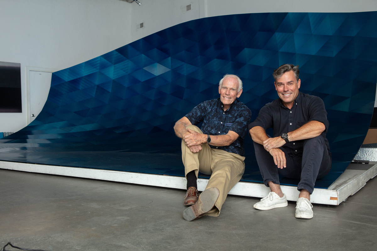 Alex Rasmussen with his father, Neal Charles Rasmussen, inside the curl of the 24-foot-long modular blue wave.