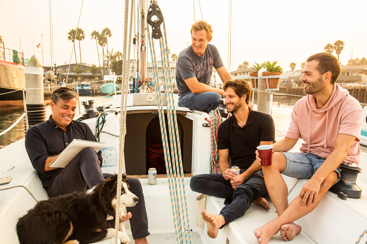 Alex Rasmussen (left) gets together regularly for design meetings and team sailing with members of his staff.