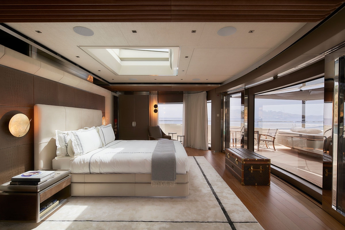 The master stateroom on the owner's deck provides panoramic views though the full-height sliding doors over the foredeck and a private pool—one of three on the yacht.
