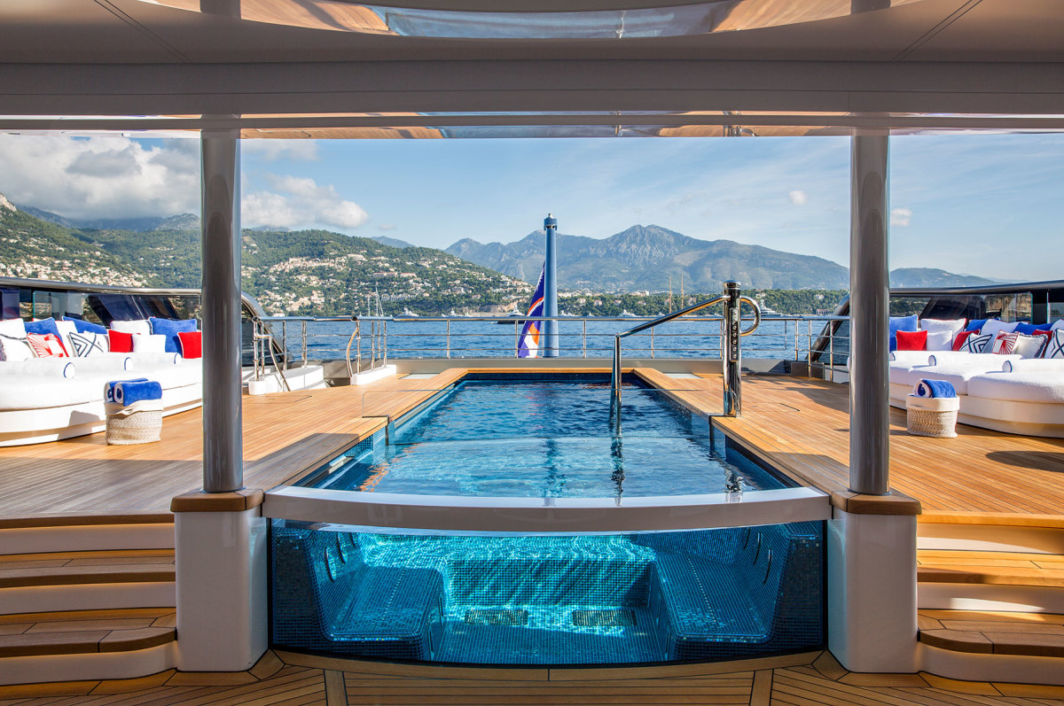 The large pool, which incorporates a hot tub, is recessed into the main deck at the stern.