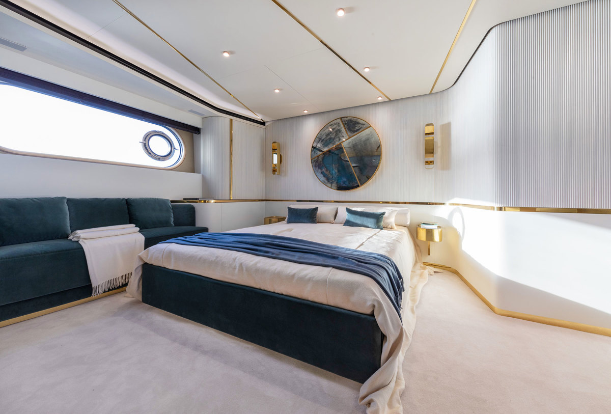 The full-beam master stateroom with an art piece by De Cotiis on the wall.