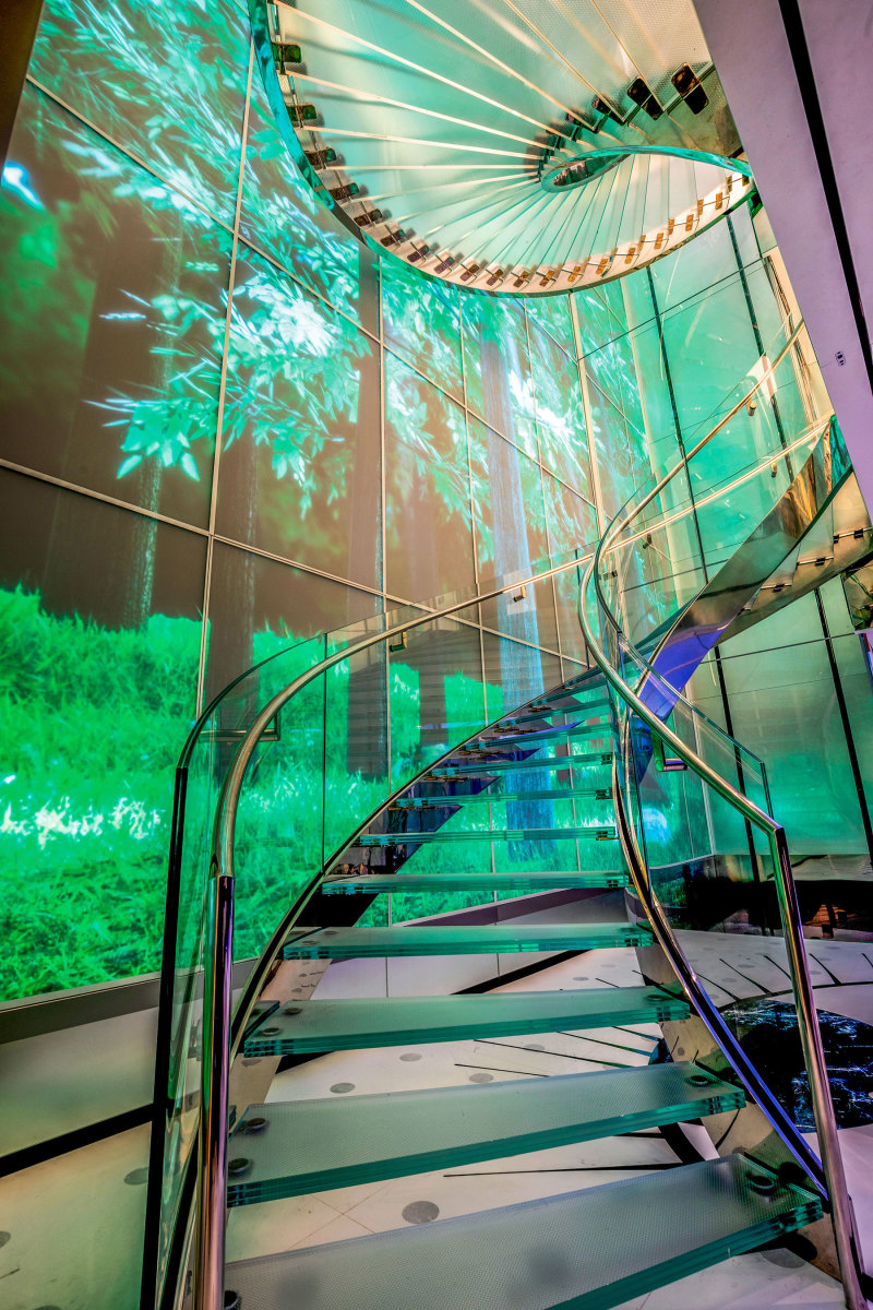 The interactive LED rainforest video wall runs down the five-deck stairwell and out along the main deck.