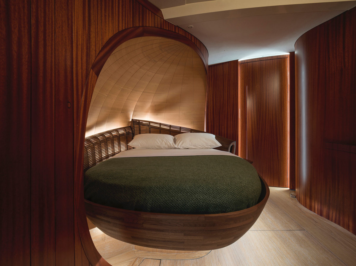 The cocooned VIP suite echoes the compound curves of the master stateroom.